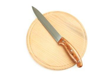 Kitchen knife on kitchen board