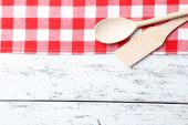 Fotografie wooden spoon and napkin on white background