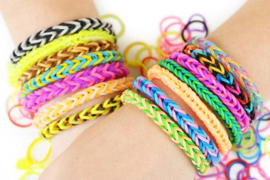 Loom bracelets on hands