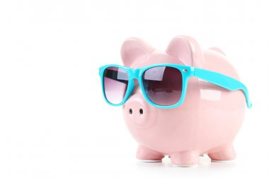 Pink piggy bank with glasses