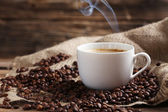 Fotografie Cup of coffee with coffee beans