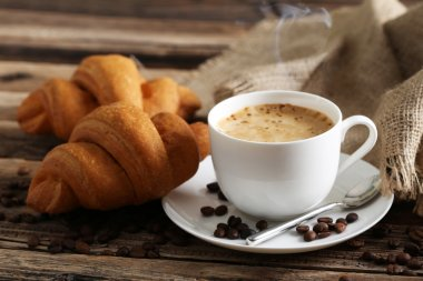 Delicious croissants with cup of coffee