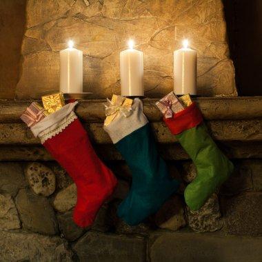 Christmas stockings on fireplace