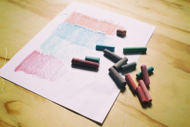 Sheet of paper and color chalks