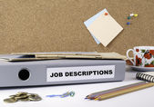 Fotografie Job Descriptions  - folder on white office des