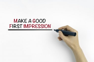 Hand with marker writing: Make a Good First Impression