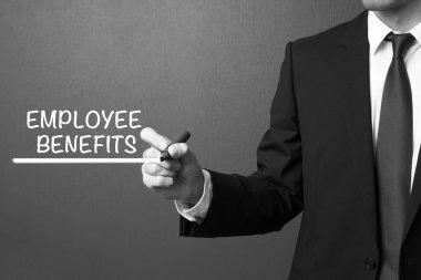Business man writing - Employee Benefits