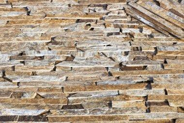 texture of marble facing bricks chipped close-up