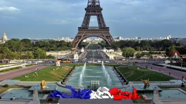 Text Paris that form in front of the Eiffel Tower
