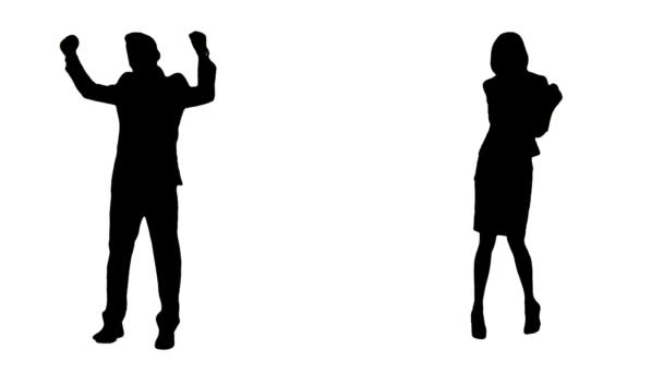 Silhouettes Of Business Couple Celebrating Success