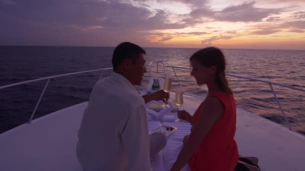 Couple Toasts With Champagne On Boat