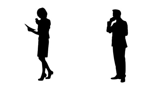 Couple of Silhouettes Of Businesspeople