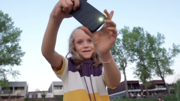 Girl Takes Photos With Mobile Phone