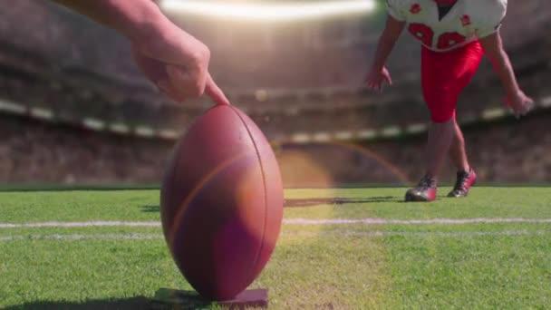 A football player kicks a field goal in a stadium