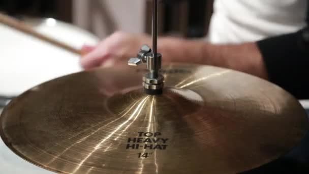Drummer plays his drums, high hat cymbal CU