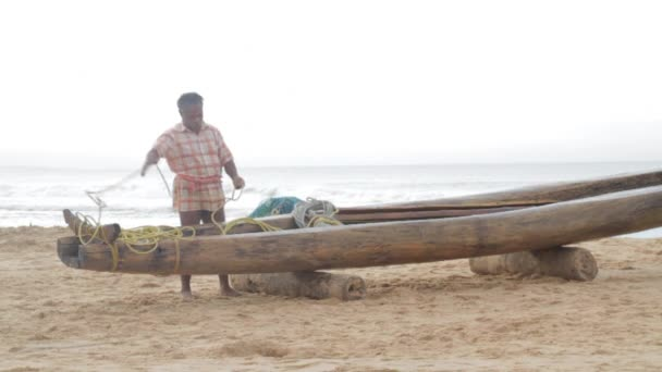 Indian man preps his traditional fishing boat