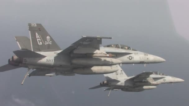 Two fighter jets in flight