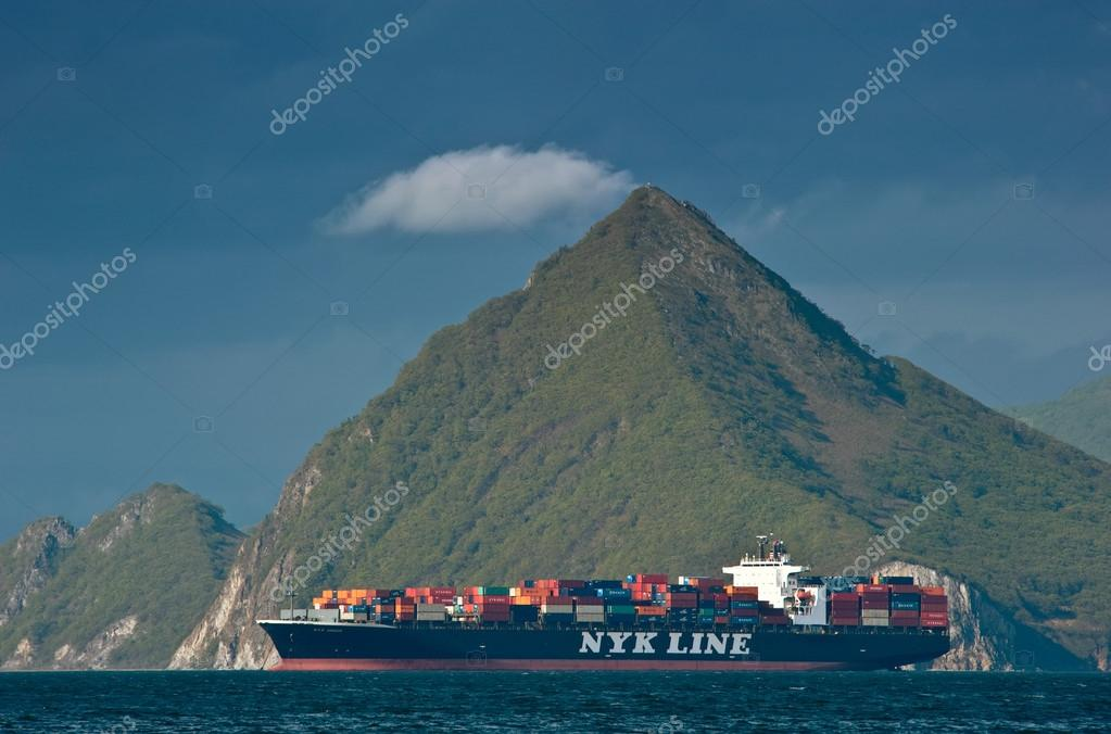 Container ship NYK Argus standing on the roads at anchor. Nakhodka Bay. East (Japan) Sea. 19.05.2015