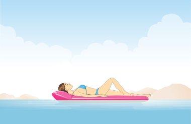 Women relaxing on inflatable mattress