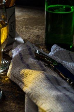 Bottle opener on a dark brown table