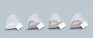Tea bags with leaves and herbs. Vector realistic set of transparent pyramid shape teabags with blank white tag on string. Empty 3d sachet isolated on gray background icon