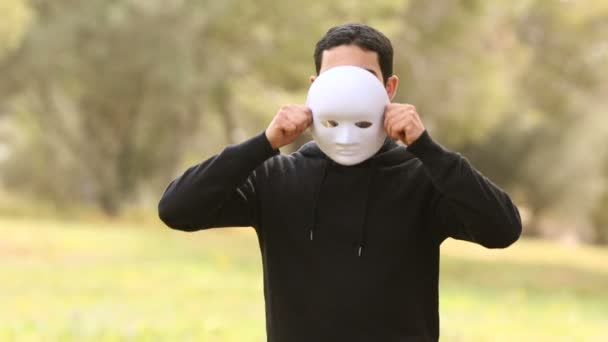 young man with mask representing aggressive emotions,for psychology concepts