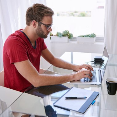 professional in red shirt busy typing
