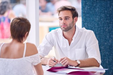 Businessman paying attention to his female partner during business meeting