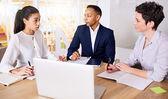 Three dynamic entrepreneurs meeting