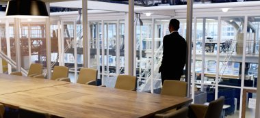 Businessman standing in empty conference room