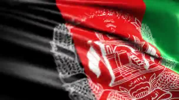 close up view of the islamic state afghanistan flag waving in the wind.