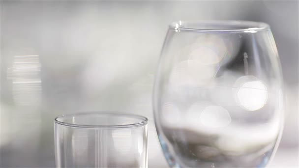 Empty glasses for wine and water set on a festive table in a restaurant, focus shift of glassware. Table decoration