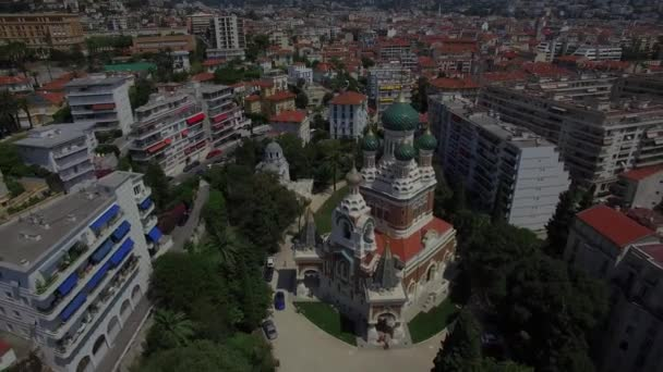 4K Russian churches abroad Christian religious architecture aerial view from above. Famous tourism sights in Europe flying over Orthodox St Nicholas Cathedral in Nice district in France - zooming out