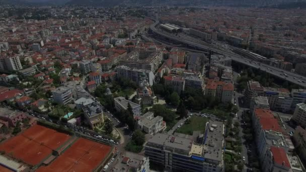 Nice city touristic sight aerial France 4K. Fly over Russian Orthodox St Nicholas Cathedral in French district urban cityscape - buildings with highway road traffic at background top view zooming in