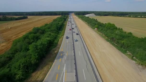 Building constructing widening multilane highway road aerial top above view 4K HD. Cars and lorry trucks moving autobahn in Europe, Germany. Transportation cargo delivery logistics business vehicles