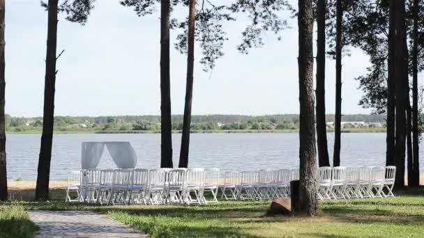 Outdoor wedding decoration rows of chairs at lake bank are ready outdoor wedding decoration rows of chairs at lake bank are ready for open air wedding ceremony junglespirit Choice Image