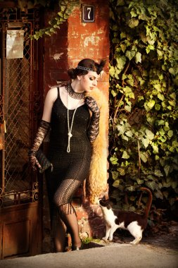Retro Woman 1920s - 1930s Standing with a Cat