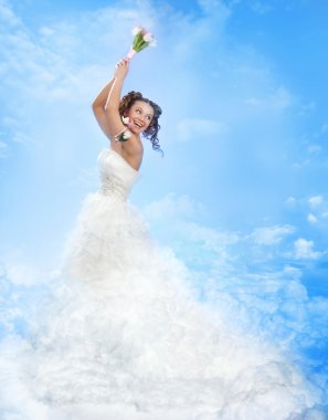 Happy Laughing Bride Throwing a Bowquet in the Sky