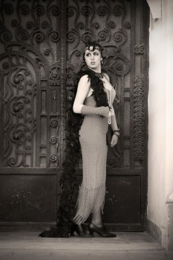 Retro Woman 1920s - 1930s Standing in the Gate