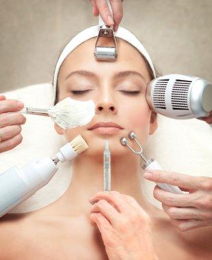 Spa Salon: Young Beautiful Woman Having Different Facial Treatment stock vector