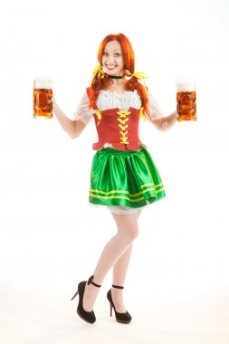 Happy Woman in Traditional Costume Holding Two Beer Glasses..