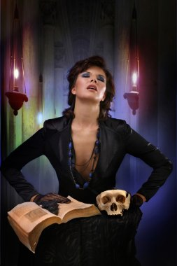 modern sexi witch casts a spell on the old background