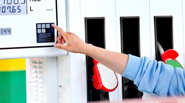 Woman Runs a Car Gas Station, Gas Pumps in the Sun stock vector