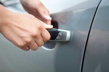 Woman Hand Holding Key Car to Unlock,