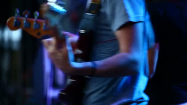 Guitars in live action at a concert (rack focus)