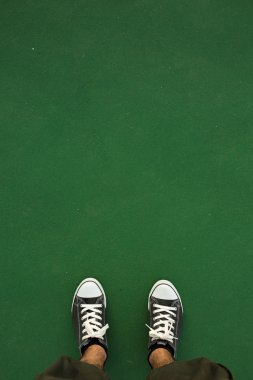 Green concrete on standing,human shoes