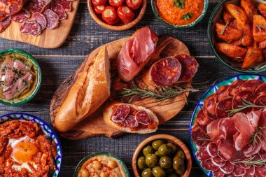 Typical spanish tapas concept, rustic style,  top view.