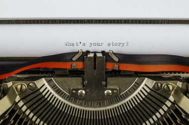 What's your story? word printed on an old typewriter