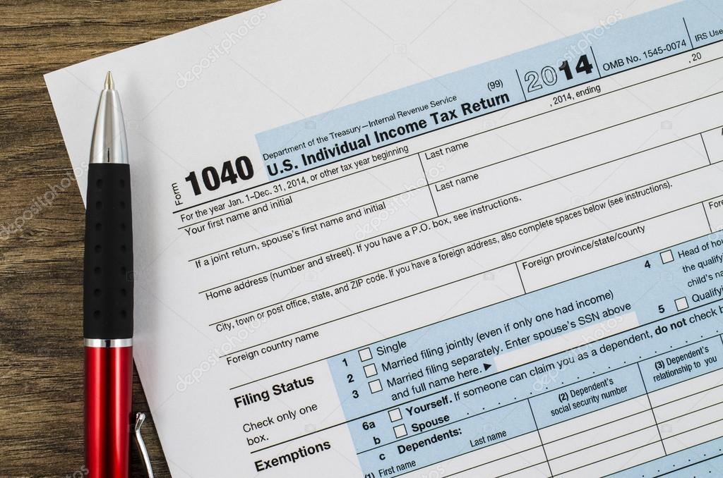 Us Individual Income Tax Return Form 1040 With Pen Stock Photo