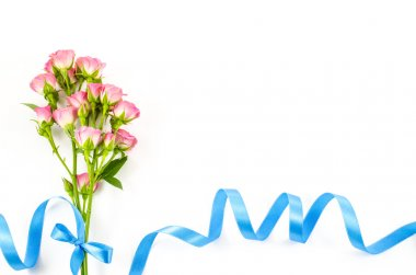 Empty white background with colorful flowers and blue ribbon